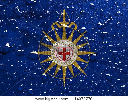flag of Anglican Communion with rain drops