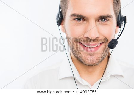 A Close-up Photo Of Smiling Young Agent Of Call Centre