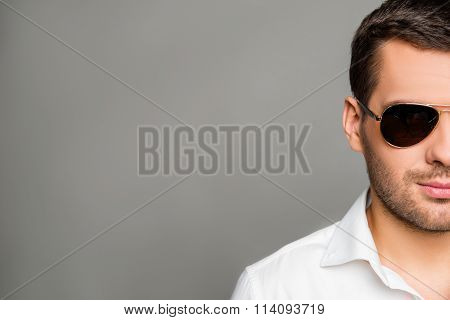 Close up photo of preety  man touching spectacles