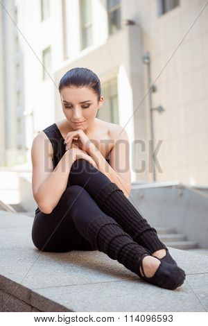 Minded  Ballerina Sitting On The Balusters