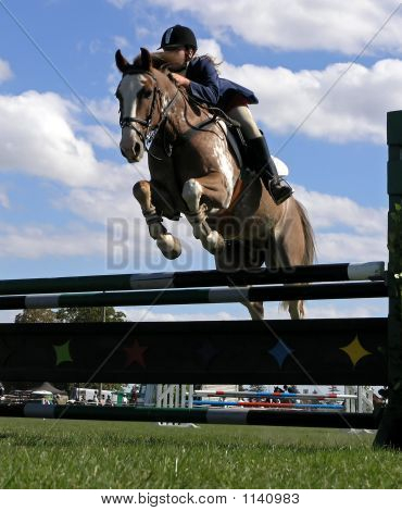 Horse And Rider Over A Jump