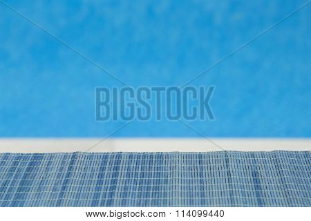 Bamboo straw mat with swimming pool blue background