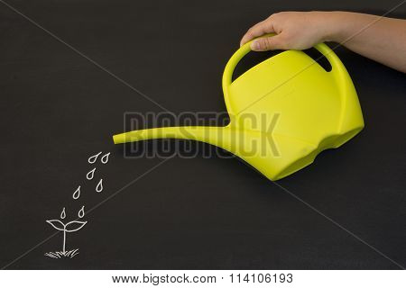 watering can on blackboard