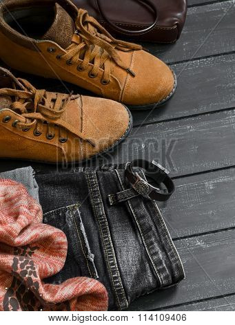 Women's Clothing And Accessories - Boots, Jeans, Scarf, Bag, On Dark Wood Surfaces, Vintage Style