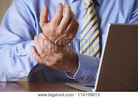 Businessman Suffering From Repetitive Strain Injury (rsi)