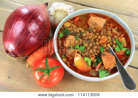 Brown Lentil Soup With Sausage And Ingredients.