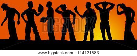 Silhouette Of A Group Of Cowboys In The Sunset