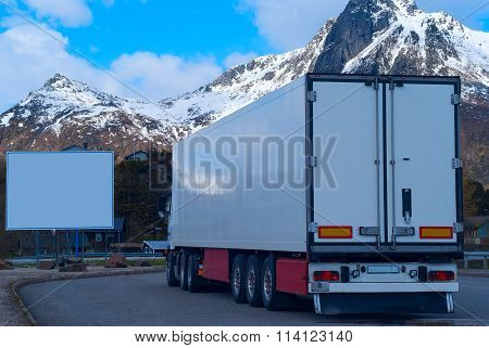 White Refrigerated Truck And Big White Billboard