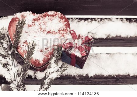 Red Heart Shaped Tin Box With A Gift Box And A Fragment Of A Pine-tree Branch