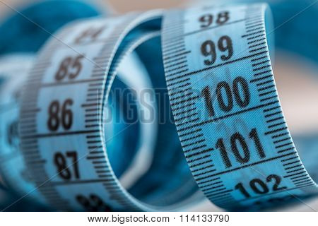 Curved measuring tape. Measuring tape of the tailor. Closeup view of blue measuring tape. Tape meas