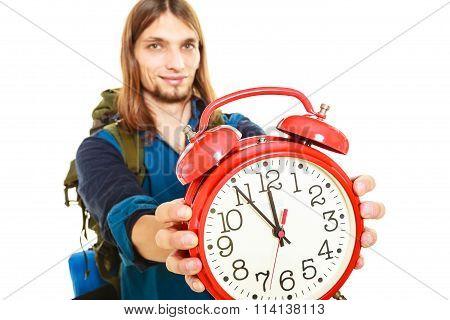 Travel Time Season. Man Backpacker Holding Clock.