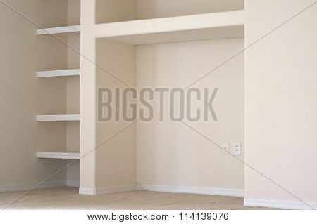 Empty Wall With Built In Shelves