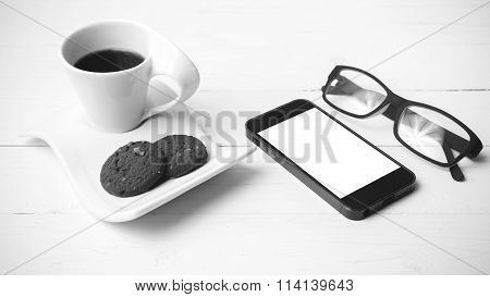 Coffee Cup With Cookie,phone And Eyeglasses Black And White Color