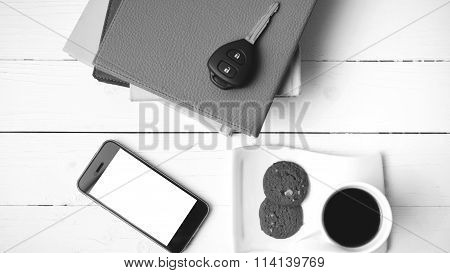 Coffe Cup With Cookie,phone,car Key And Stack Of Book Black And White Color