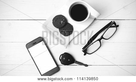 Coffee Cup With Cookie,phone,eyeglasses And Car Key Black And White Color