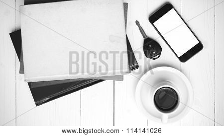 Coffee Cup With Phone,car Key And Stack Of Book Black And White Color