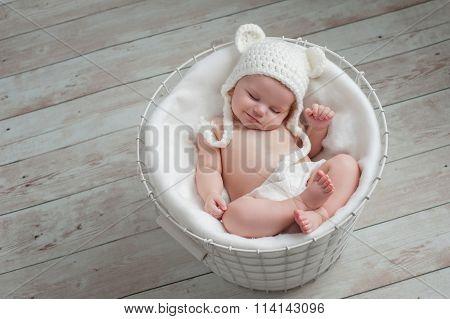 Smiling Baby Wearing A White Bear Hat