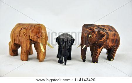 three wooden elephants