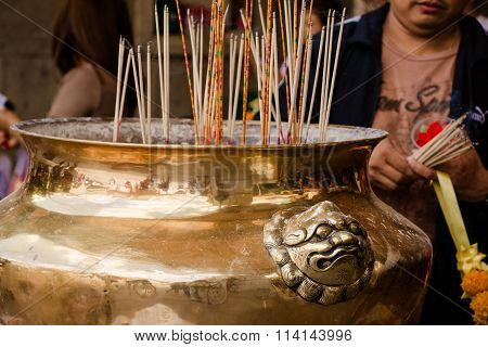 Joss Stick Burn On Th Box At Chinese Shrine For Making Merit In Chinese New Year Festival. Pray For