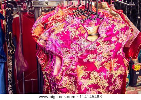 Qipao, Cheongsam,  Or Chinese National Dress Sell On The Street At China Town. People Look And Buy