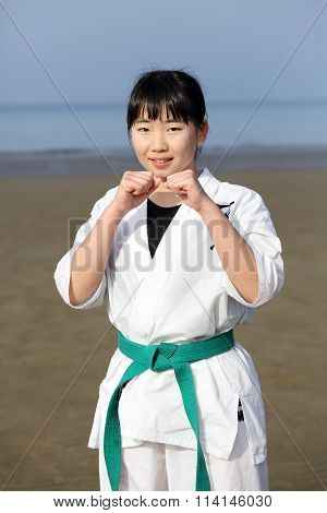 Japanese karate girl at the beach