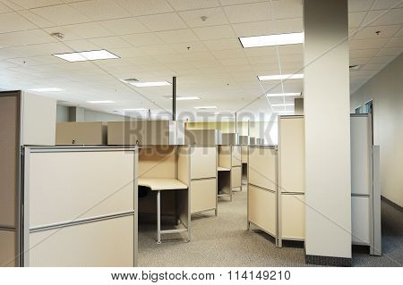 empty cubicles inside office building