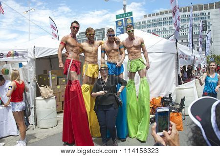 Diageo Smirnoff guys pose for a photo with unidentified participant at the Gay Pride Festival.