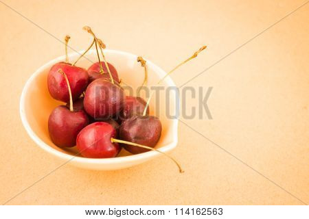 Bowl Of Cherries On Warm Vintage Background