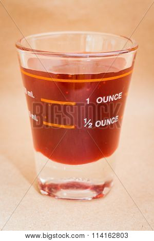 Glass Shot Of Strawberry Syrup