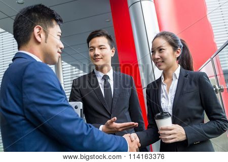 Businessman introduce a new partner to his boss