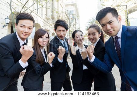Group of business people cheerp up with holding arm fist together