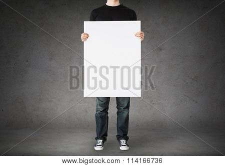 close up of man holding big blank white board