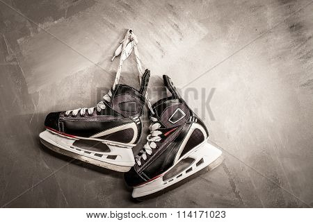 the skates weigh on the wall