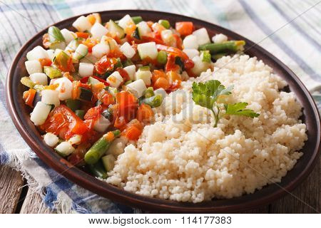Tasty Couscous With Vegetable Salad Close-up On A Plate. Horizontal