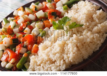 Vegetarian Food Couscous With Vegetable Salad On A Plate. Horizontal