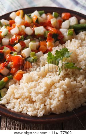 Couscous With Vegetable Salad On A Plate Macro. Vertical