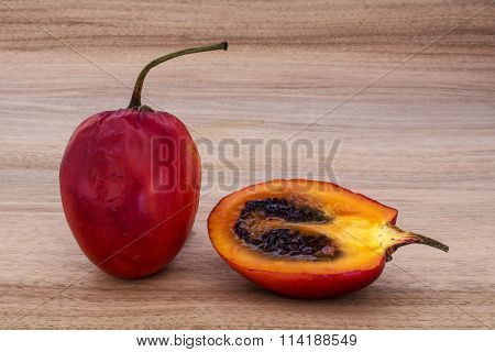 Tamarillo whole and halved