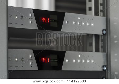 Audio converters mounted on a rack.
