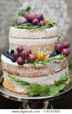 Beautiful Two-tiered Wedding Cake On The Table