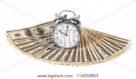 Alarm clock on dollar bills isolated