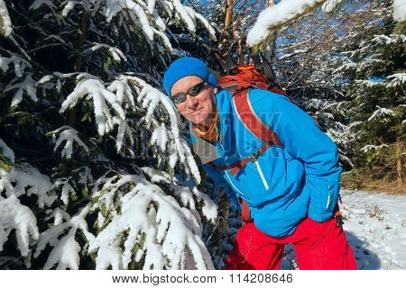 Happy Hiker Man In Winter Forest Enjoying Life In Sunny Winter Day.