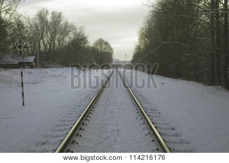 Railway in the winter, going into the distance