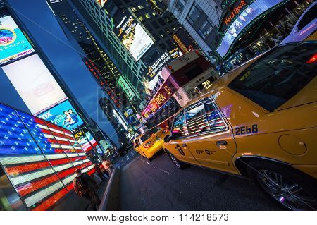 NEW YORK CITY -JULY 10: Times Square featured with Broadway Theaters and animated LED signs is a symbol of New York City and the United States July 10 2015 in Manhattan New York City. USA.