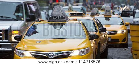 NEW YORK CITY - JULY 10: Taxi on Times Square an iconic street of New York City and America July 10 2015 in Manhattan New York City.