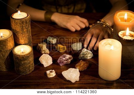 a lot of healing stones candles and fortune teller hands concept life coaching poster