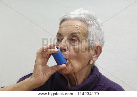 Old Woman With An Inhaler