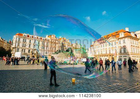 Unidentified young woman makes soap bubbles in Prague, Czech Republic