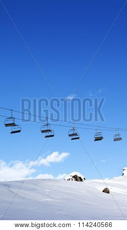 Chair-lift And Blue Sky At Evening