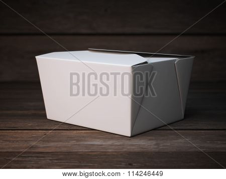 Blank white package on the wooden floor