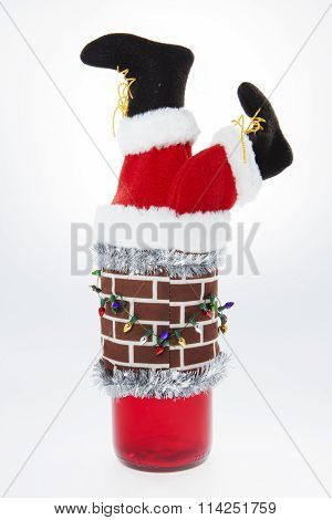 A wine bottle cover showing Saint Nick coming down the chimney poster